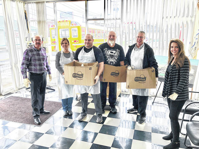 Mason County Schools representatives recently dropped off leftover meal bags for children of City of Point Pleasant employees. Pictured from left are, Mayor Brian Billings, Manuela Hall, Board of Education President Jared Billings, Charlie Perry, Richard Browning and City Clerk Amber Tatterson.