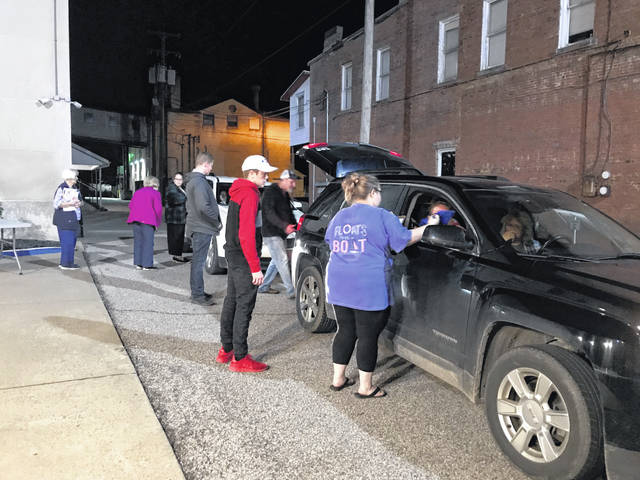 """Staff with Mason County Clerk Diana Cromley's office and election workers, are pictured collecting the ballots from precincts from across the county during a """"normal"""" election night in 2018. This year's primary election is anything but normal."""
