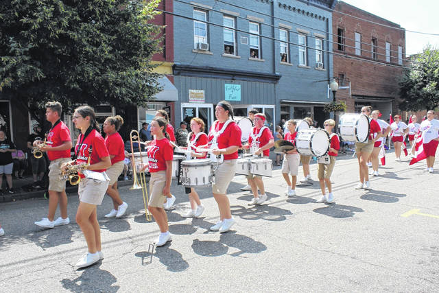 Wahama Band members in summer march in last year's Mason County Fair Parade. The band is in need of new uniforms for fall and competition season.