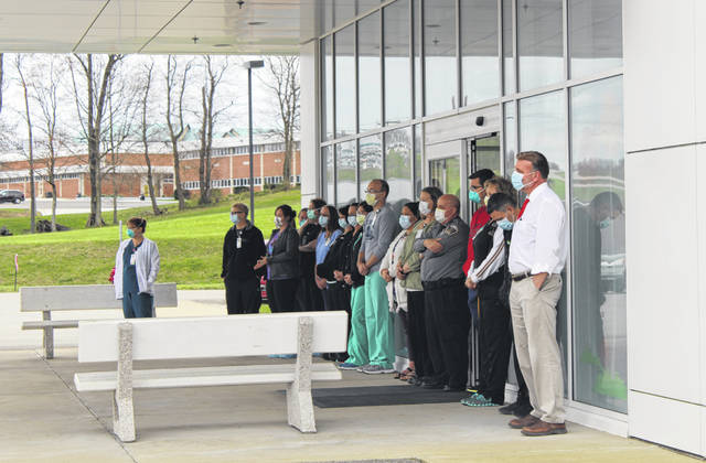 Holzer Meigs Emergency Department staff stood in front of the ER as the caravan sang, prayed for them and expressed gratitude for the work they are doing during the COVID-19 pandemic.