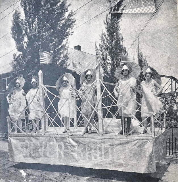 "From the December 15, 1969 Silver Memorial Bridge Dedication Edition of Ohio Valley Publishing: ""Colorful floats were attention getters at the dedication of the Silver Bridge in 1928. The above picture is of a float that participated in that dedication. Clothes worn by the women riding on the float were designed by Nan Deardorff, Gallipolis. Riding on the float, left to right, are Nada France, Elizabeth Kenney Liter, Irene Schneider Johnson, Nell Hanner, Virginia Mehl, Virginia Woelwffel Johnson."" (OVP File Photo)"