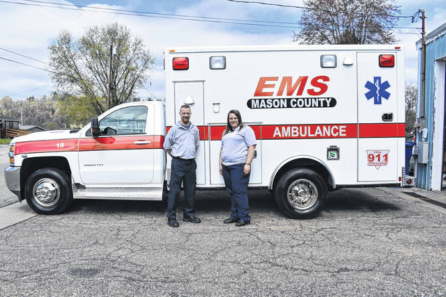 Mason County EMTs Howard Wood, left, and Holly Davis stand outside of the new ambulance that went into service Monday at the Mason EMS station. The vehicle replaces one that was involved in a rollover accident last summer.