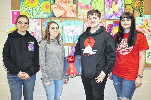 Four art students from Wahama High School began March, which was designated Youth Art Month, with their works being chosen to hang in an art center in Parkersburg. Pictured, from left, are Sydney Burris, Allison Tennant, Peyton Ingels, and Addisyn Williams. Ingels was also a winner in the recent Congressional Art Awards competition in Charleston, while Williams was a winner in Parkersburg.