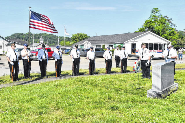 """The Stewart-Johnson V.F.W. Post 9926 of Mason and Smith-Capehart American Legion Post 140 of New Haven remembered their fallen comrades Monday in a series of Memorial Day ceremonies throughout the Bend Area. Services were held in Clifton, Mason, Hartford and New Haven. Wreaths were placed at each veterans monument, along with a gun salute and the playing of """"Taps."""" Many area residents attended, remembering the true meaning of the day. (Mindy Kearns 
