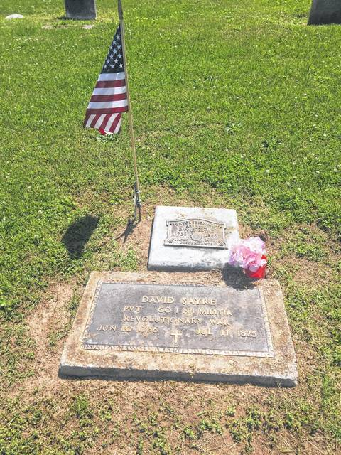 A flag is placed on the grave of Revolutionary War veteran David Sayre at Letart Falls Cemetery.