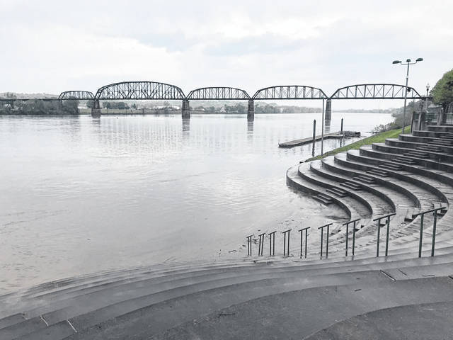 The rains caused flooding issues this past weekend in various locations across Mason County. At Riverfront Park in Point Pleasant, the Ohio River crept into the amphitheater but by Monday morning had fallen back into its banks for the most part. Pictured is the park on Saturday shortly after the river crested at 33.5 feet. Flood stage in Point Pleasant is 40 feet. More rain showers are forecast for the majority of this week. (Beth Sergent | Register)