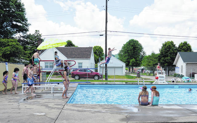 Pictured is opening day at the New Haven Municipal Swimming Pool last May.