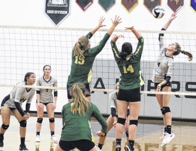 River Valley's Mikenzi Pope, right, leaps for a spike attempt during a TVC Ohio match against Athens on Sept. 10, 2019, in Bidwell, Ohio.