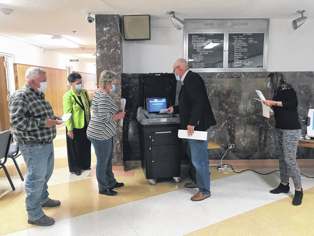 Commissioners tested the ballot boxes at the courthouse before the meeting on Thursday. Pictured from left are Commissioner Sam Nibert, County Clerk Diana Cromely, Commissioners Tracy Doolittle and Rick Handley, and Point Pleasant City Clerk Amber Tatterson.
