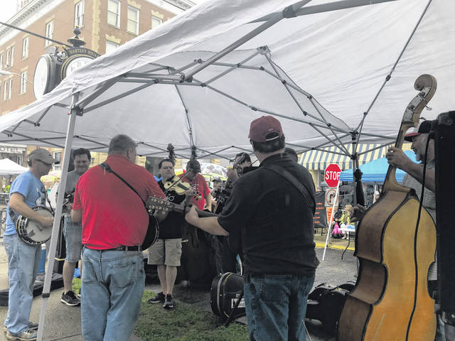 The annual Bikes, BBQ & Bluegrass festival was one of several June events on the Mason County tourism schedule that was cancelled due to the COVID-19 outbreak. Pictured are local bluegrass musicians performing at Gunn Park prior to the evening concert at last year's event.