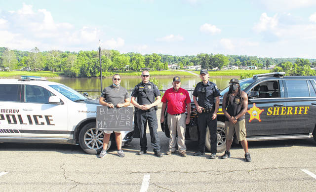 Organizers of the Pomeroy Black Lives Matter Protest Isaiah English and Cornelius English are pictured with Meigs County Sheriff Keith Wood, Pomeroy Police Chief Chris Pitchford and Pomeroy Officer Leif Babb prior to the event in Pomeroy.