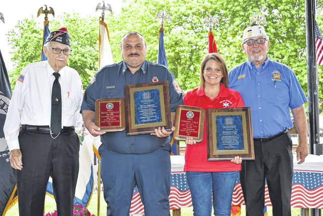 Two Mason County first responders, chosen as among the best by the Stewart-Johnson V.F.W. Post 9926 of Mason, were announced as being both winners on the state and national level during Awards Day on Sunday. Pictured, from left, are V.F.W. member Milford Mowrey; Steven Sigman, National V.F.W. Firefighter of the Year; Elisabeth Lloyd, National V.F.W. EMT of the Year; and V.F.W. Commander Ray Varian. (Mindy Kearns | Courtesy)