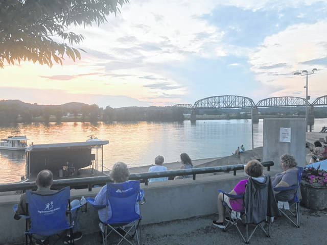 Pictured is a scene from last Friday's Mayor's Night Out performance, featuring Brent Patterson. Attendees to Riverfront Park were practicing social distancing, providing space between other groups. (Beth Sergent | OVP)