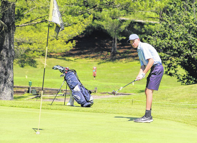 Brennen Sang, of Point Pleasant, W.Va., watches a putt go in on the ninth hole during Thursday's second week of the Meigs Golf Course Junior League being held in Pomeroy, Ohio.