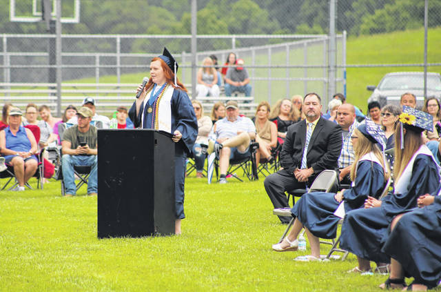 Hannan senior Sydney Holley speaks both to the crowd and to her classmates at the podium on Saturday during the 2020 Hannan High School commencement ceremony held in Ashton, W.Va.