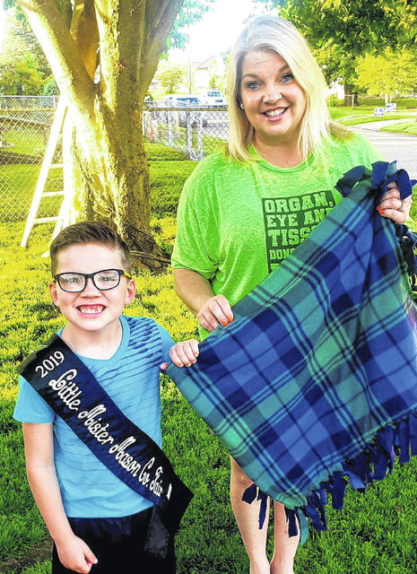 Little Mr. Mason County Bryson Sweeney and his mother, Brandy, pictured, found a way to stay busy during the COVID-19 stay-at-home period. They celebrated April's Donate Life Month by making no-sew blankets for organ donor families. The Center for Organ Recovery & Education provided the materials and Bryson and Brandy said they made each blanket with love, knowing organ procurement coordinators will give each blanket to a donor family.