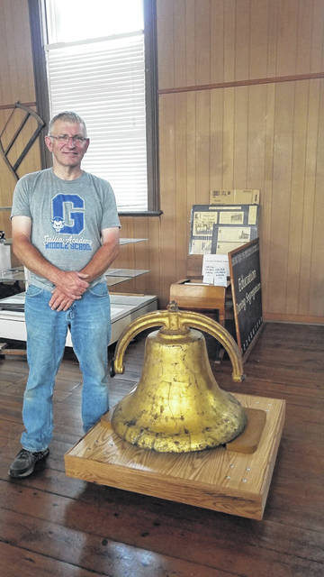 "Rick Stout is pictured with the platform he contructed for the bell which was formerly housed at what was known as the ""Lincoln Colored School."" Also pictured, Bryson Payne, fastening the new sign for the John Gee Black Historical Center made and donated by Chuck Conley of Auto Trim Center. (Robin Payne 