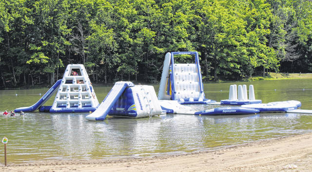 The Aqua Park at Kountry Resort Campground provides several obstacles, a climbing wall and multiple slides for visitors to enjoy.