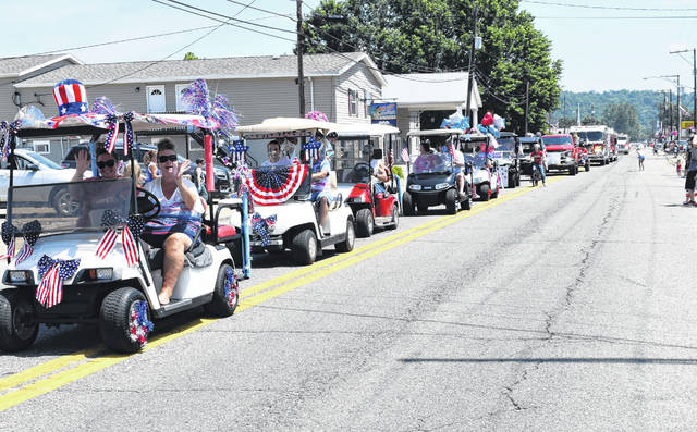 "The ""golf cart brigade"" was among the entries in the Mason Fourth of July parade."