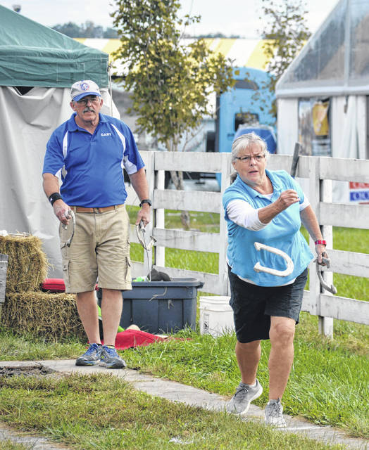 Catching up and pitching horseshoes at the Bob Evans Farm Festival. (OVP File Photo)