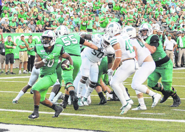 Marshall running back Brenden Knox (20) busts through the Ohio defense for a second quarter touchdown on Saturday, Sept. 14, 2019, at Joan C. Edwards Stadium in Huntington, W.Va.