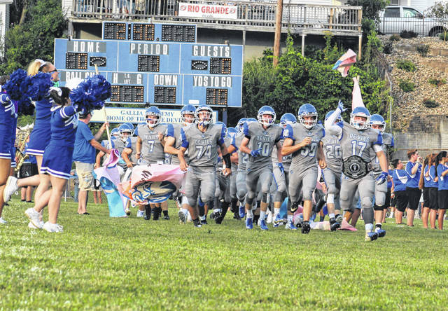 Members of the Gallia Academy football team take to the field for a Week 1 contest against Meigs on Aug. 23, 2018, at Memorial Field in Gallipolis, Ohio. All Ohio high school contact sports, particularly football, received a green light on Tuesday as Governor Mike DeWine announced that the 2020 OHSAA fall sports season could move forward during the coronavirus pandemic.