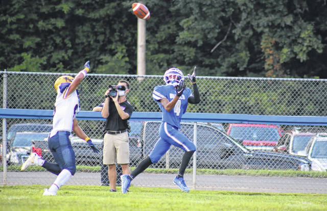 Gallia Academy junior Daunevyn Woodson (4) hauls in a 35-yard touchdown pass in front of a South Point defender, during the Blue Devils' 41-0 win on Friday in Gallipolis, Ohio.