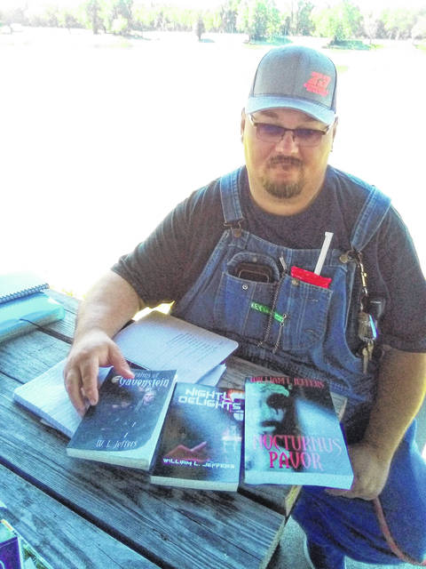William Jeffers, writers guild member, is pictured here with his three published books.
