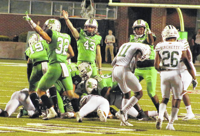 Members of the Marshall football team react after recovering a fumble in the third quarter of a Sept. 14, 2019, football game against Ohio at Joan C. Edwards Stadium in Huntington, W.Va.