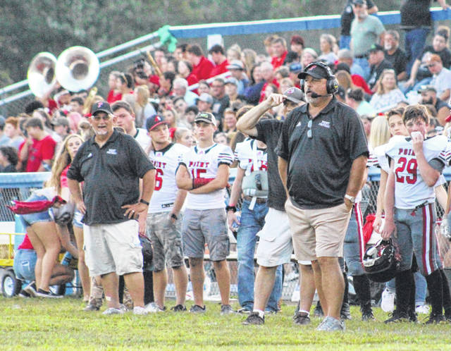 Point Pleasant football coach David Darst, right, looks on from the sideline during the 2019 football game against Gallia Academy at Memorial Field in Gallipolis, Ohio. (Bryan Walters|OVP Sports)
