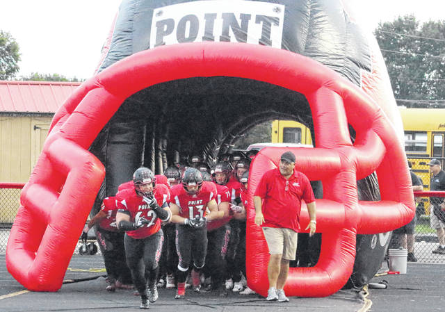 Point Pleasant football coach David Darst, right, gives the go-ahead for his team to take the field before the start of a 2018 football game at Ohio Valley Bank Track and Field in Point Pleasant, W.Va.