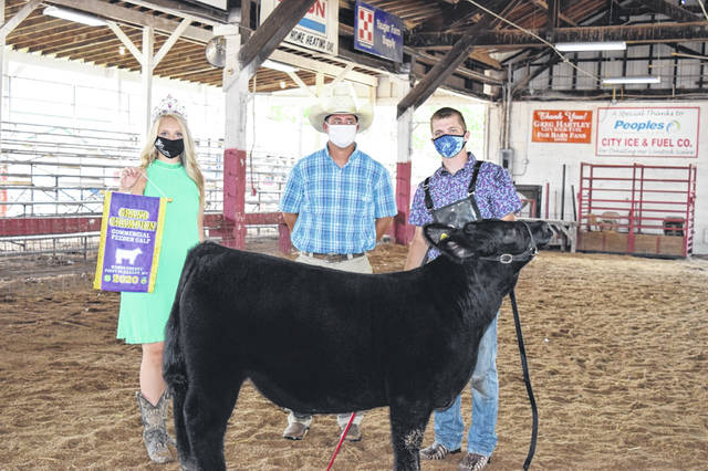 Cattle ruled the show ring on the Mason County Fairgrounds last week. Colton Arrington, pictured, showed the Grand Champion Feeder Calf, while Eden Johnson, pictured, showed the Reserve Champion Feeder Calf, alongside the judge for the show and Mason County Fair Queen Marlee Bruner. Also, Garrett Turley showed the Grand Champion Market Steer and Sydney Facemyer showed the Reserve Champion Market Steer (see inside this edition and online at www.mydailyregister.com). The Mason County Fair Board sponsored two days of shows and the livestock sale. More on the livestock sale in an upcoming edition. (Heidi Sturgeon Wood | Courtesy)