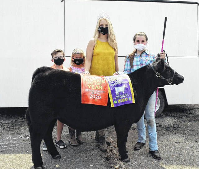 Ava Roach showed the Grand Champion Replacement Heifer on Wednesday at the Mason County Fairgrounds. Roach was also awarded Rookie of the Year. Pictured from left are 2020 Little Mister Bryson Sweeney, 2020 Little Miss Wrylie Conrad, 2020 Fair Queen Marlee Bruner and Roach.