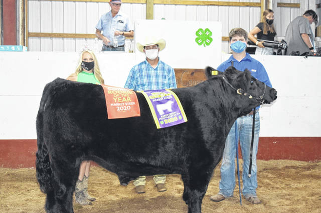 Garrett Turley showed the Grand Champion Market Steer at the Mason County Livestock Show. Pictured from left are 2020 Mason County Fair Queen Marlee Bruner, the beef judge and Turley.
