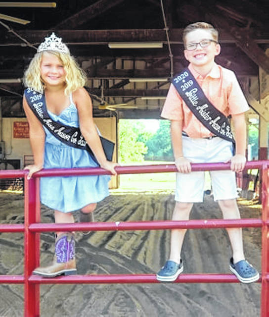 The 2019 Little Mister and Miss Mason County Fair royalty are keeping their titles for 2020. Little Miss Wrylie Conrad and Little Mr. Bryson Sweeney are pictured here with their new sashes that represent 2019 and 2020. The Junior Women's Club directs the pageant each year and decided to extend the reign of Sweeney and Conrad. The fair begins its three days of limited events, hosting only livestock shows and the livestock sale. Today, the market hog show is at 9 a.m., followed by the replacement heifer show at 2 p.m. and ending with the market goat show at 7 p.m. Thursday's shows will start with feeder calves at 9 a.m., market lambs at 2 p.m. and market steers at 7 p.m. The livestock sale begins at 11 a.m. on Friday morning.