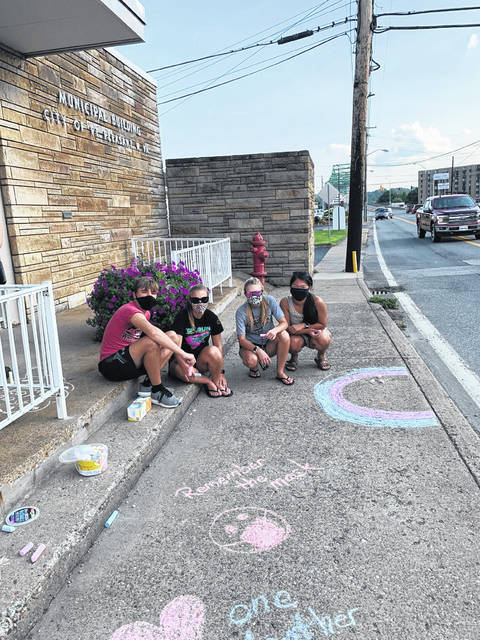 Members of the Presbyterian Church Youth Group spread messages with sidewalk chalk around Point Pleasant. Pictured from left are Parker Henderson, Kira Henderson, Kate Henderson and Gracie Queen.