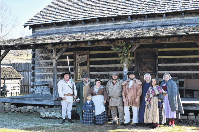 Volunteers on the Fort Randolph Committee are pictured in front of the tavern during the 2019 Christmas on the Frontier.