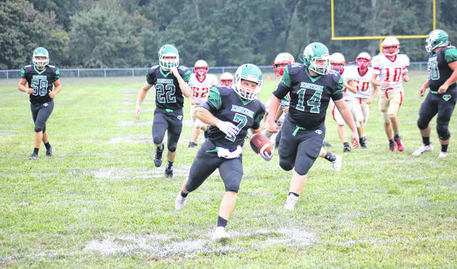 Eastern senior Blake Newland (7) crosses the goal line at the end of a 26-yard touchdown run, giving the Eagles a 6-0 lead a minute into Friday's TVC Hocking bout at East Shade River Stadium in Tuppers Plains, Ohio.