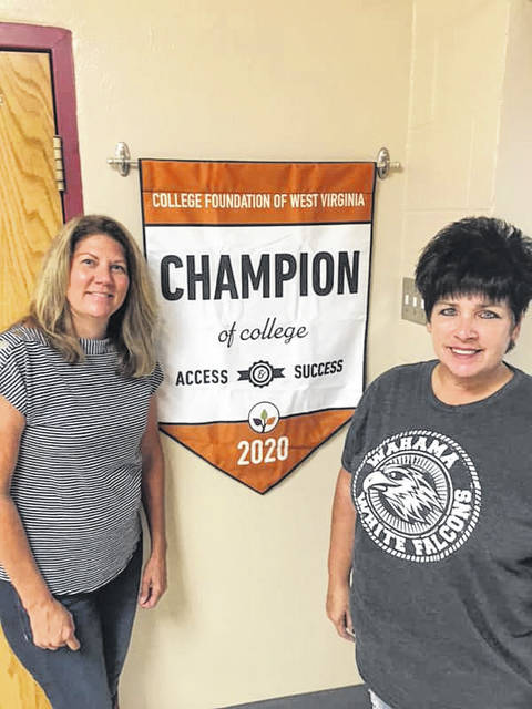 Wahama High School Principal Melissa VanMeter, right, and Counselor Teresa Murphy are pictured with a banner designating the school a 2020 West Virginia High School Champion of Access and Success. It is the second year in a row the Bend Area school has received the award. (Courtesy photo by Mason County Schools.)