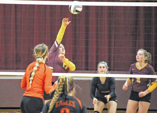 Meigs senior Katie Hawkins (17) spikes the ball in front of teammates Jerrica Smith and Andrea Mahr (2), during the Lady Marauders' win on Monday in Rocksprings, Ohio.