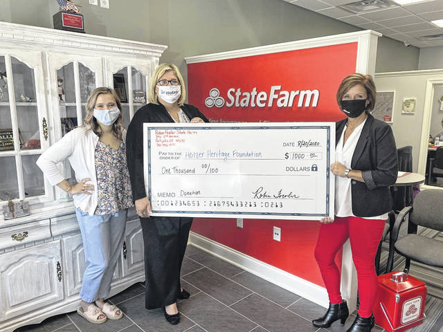 Robin Fowler, Gallipolis State Farm agent of more than 20 years, pictured at right, recently presented a check to the Holzer Foundation representatives, Abby Greer, manager, Holzer Heritage Foundation, at left, and Amee Rees, director, Holzer Heritage Foundation, Gift Shop and Event Fundraising. (Holzer Health System | Courtesy)