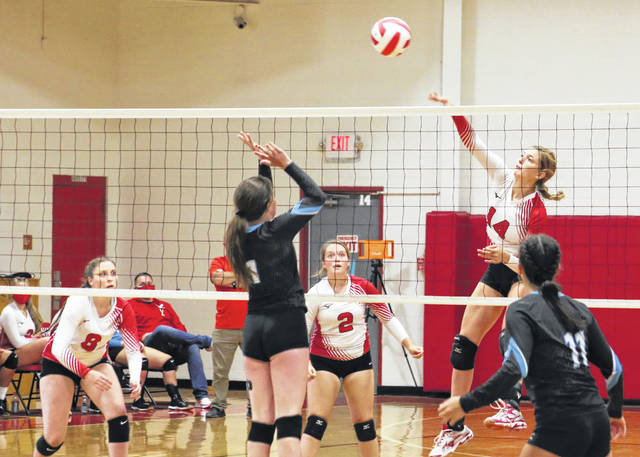 Wahama senior Emma Gibbs (14) hits a spike attempt during Tuesday night's non-conference volleyball match against Lincoln County in Mason, W.Va.