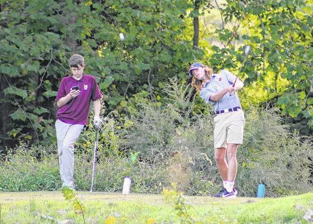 Point Pleasant senior Kyelar Morrow, right, hits a tee shot on the ninth hole during a golf match on Sept. 22 at Riverside Golf Course in Mason, W.Va.