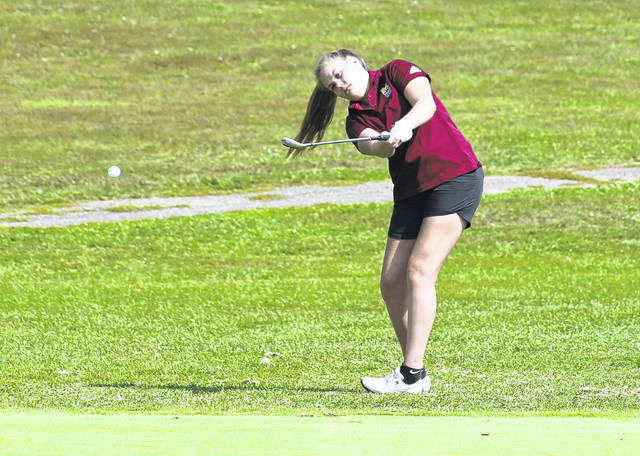 Meigs senior Kylee Robinson hits a chip shot onto the 14th green during Monday afternoon's Division II sectional girls golf tournament at Franklin Valley Golf Course in Jackson, Ohio.