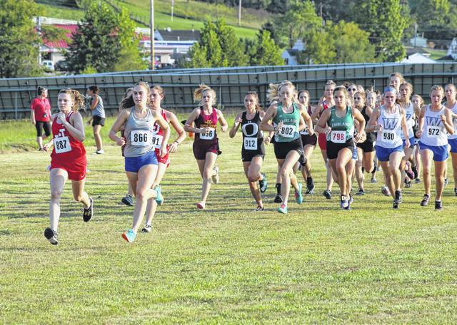 Gallia Academy senior Sarah Watts, second from left, sprints out ahead of the pack at the start of the 2020 Skyline Bowling Cross Country Invitational varsity girls race held Tuesday at Gallia Academy in Centenary, Ohio.