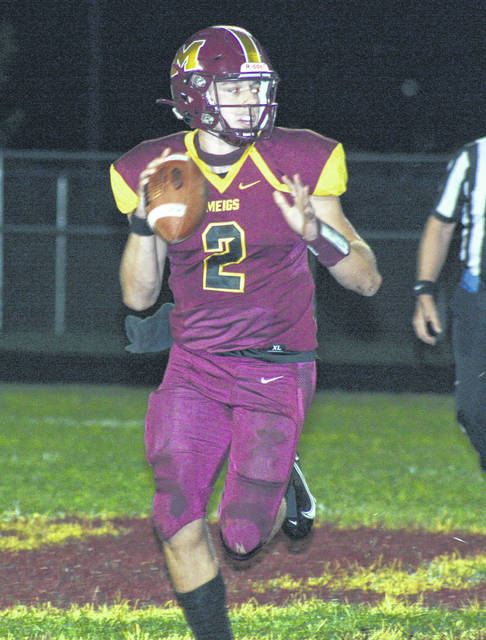 Meigs junior Coulter Cleland looks to deliver a pass downfield during the second half of Friday night's TVC Ohio football contest against River Valley at Farmers Bank Stadium in Rocksprings, Ohio.