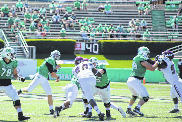 Marshall quarterback Grant Wells rifles a pass downfield during the first quarter of Saturday afternoon's season-opening football game against Eastern Kentucky in Huntington, W.Va.