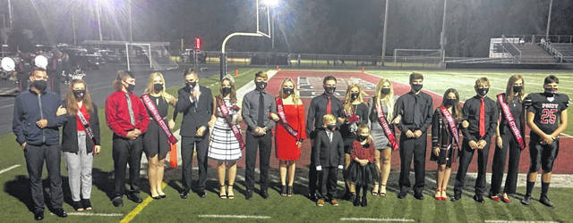 "Pictured from Friday's PPHS Homecoming festivities, from left, Brent Sang with 2019 Homecoming Queen Carlee Sang, Escort Luke Moffitt with Sophomore Attendant Kylie Price, Escort Luke Blain with Band Sweetheart Kenly Arbogast, Escort Lane Rollins with Senior Attendant Cailey Payne, Escort Mitchell Freeman with 2020 Homecoming Queen Kira Henderson, Crown Bearer Lucian Dickens and Flower Girl Addison Withrow, Senior Attendant Makayla Gibbs with Escort Richard See, Junior Attendant Trinity Epling with Escort MaKandle ""Jake"" Freeman, Freshman Attendant Kendal Connolly with Escort Aden Dvosis. (Alex Hawley 
