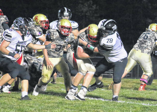 River Valley junior Christopher Goheen (78) wraps up South Gallia running back Ean Combs during the first half of Friday night's football contest in Mercerville, Ohio.