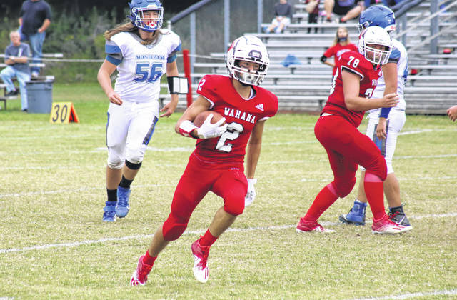 Wahama sophomore Kase Stewart (2) scores on a five-yard run, his second of three touchdowns, during the first quarter of the White Falcons' 66-29 victory on Saturday in Mason, W.Va.